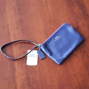 Coach small purple wristlet wallet